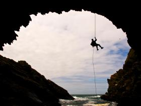 Abseil down Parliament House Cave in Anglesey